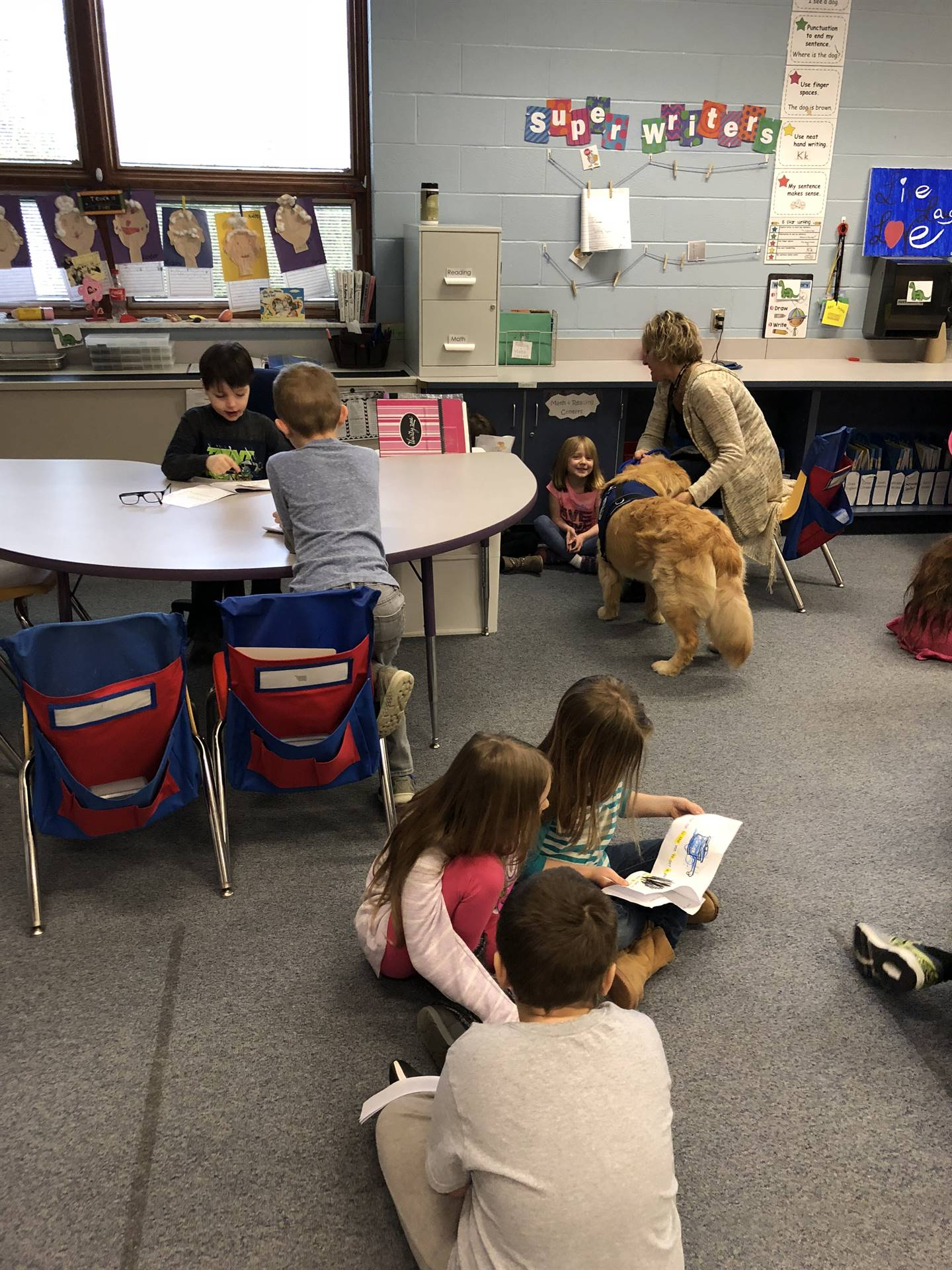 Books and Bark - Mrs. Heutsche's room welcomes Murphy the Therapy Dog!
